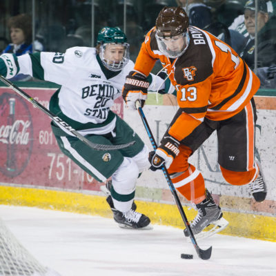 Bowling Green's Stephen Baylis (13) controls the puck against Bemidji State's Dillon Eichstadt during last weekend's semifinal series (Photo by Todd Pavlack/BGSUHockey.com).